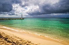 Storm clouds roll towards the beach at Cozumel, Mexico's Nachi Cocom Beach Club.  See more #photos at 75central.com #beach #mexico #cozumel