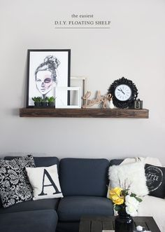 floating shelf above sofa... Clock, greenery, lamp glow, sepia pictures, FAMILY, HOME,