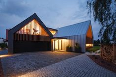 Tychy - Two Barns House: Designed by RS+, this modern take on barns demonstrates pure architectural class and imagination. The brief specified a requirement for easy access to the garden, and to be spacious yet comfortable. Inside, the cream walls are complemented by light wood furniture. Parts of the house are designed to shade one another, so that certain rooms don't take in too much sunlight in the afternoon, allowing them to cool down as the day turns to night.