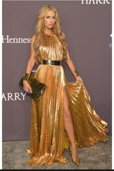 Paris Hilton wearing Maria Lucia Hohan Pleated Metallic Lurex Chiffon Gown and Manolo Blahnik BB Pointed Toe Snake Gold Heels
