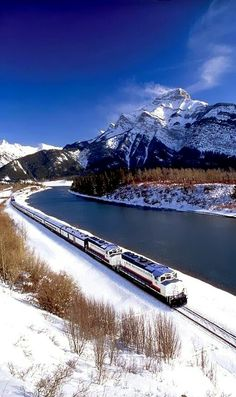 "The ""Rocky Mountaineer Train"" on the Canadian Pacific Railway through Banff National Park, Alberta – Canada. The ""Rocky Mountaineer Train"" on the Canadian Pacific Railway through Banff National Park, Alberta – Canada. Places Around The World, Oh The Places You'll Go, Places To Travel, Around The Worlds, Canadian Pacific Railway, Canadian Rockies, Banff National Park, National Parks, Lac Louise"