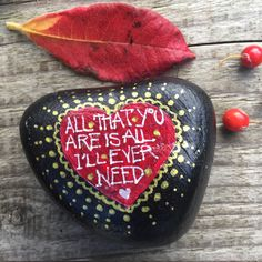 hand painted pebble/rock, heart shaped with love quote.
