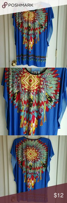 NWT FUN NATIVE AMERICAN MOTIF SZ  L NWT silky lightweight colorful blouse. Very unique. Print is reminiscent of native American patterns. Poly/spandex blend. Size tag says L (large), but I feel it is safe to say it will fit an XL. Tops Tees - Short Sleeve