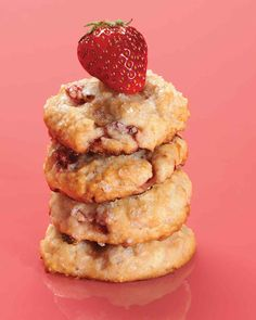 These tender cookies are made with cream and studded with sweet strawberries for a portable version of a classic dessert.