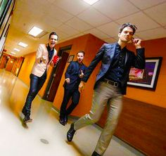 Brendon Urie and band walking