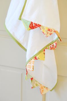 LOVE this idea from Joanna Figueroa for embellishing flour sack towels with prairie points.