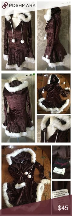 Vintage 80's Skater's Dress 🎉HOST PICK🎉 The real thing! This brown crushed velvet Vintage 80's Girl's Skater's Dress by DREAMGIRL is simply awesome vintage. Highlighted with a hood, pom-poms and faux white fur, this dress would be great for a day at the skating rink!  Zips up in the front. Size S~ shown on an adult mannequin so can be worn by a small-framed woman. Made of 100% stretchy polyester. 🎉BLACK FRIDAY HOST PICK🎉 Vintage Dresses Casual