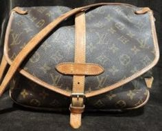 Louis Vuitton Brown Monogram Saddlebag - Vintage with flap and long strap that can serve as a cross body strap. This bag is in WELL LOVED condition.    $288.50