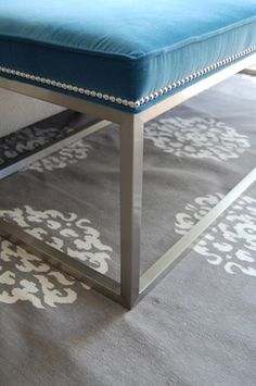 This rug and the nail head trim bench