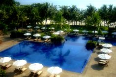 Soak in some sun and laze around the swimming pool. #clubmed #Bintan #golfcourse www.clubmed.co.in