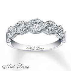 Twists of 14K white gold and round diamonds grace this attractive ring for her from the Neil Lane Designs® collection. Milgrain details complete the look. The ring has a total diamond weight of 3/8 carat. Available online while supplies last. Diamond Total Carat Weight may range from .37 - .44 carats.