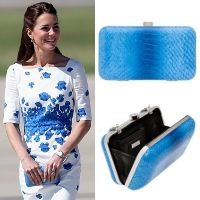Kate carried this Oroton Odeion Clutch during the Australian Tour in April 2014 in Queensland while wearing a L.K. Bennett Lasa Poppy Print Dress. The indigo blue Odeion clutch by Australia brand Oroton, is crafted from Italian embossed calf leather and metal, featuring a snake chain strap and custom designed Oroton hardware.