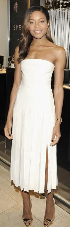 Who made Naomi Harri's gold sandals, and white strapless dress?