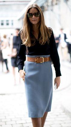 High-wasted pale blue pencil skirt, wide statement belt, dark blouse.