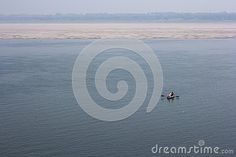 Huge river and one small boat in sacred place in Varanasi. India.
