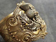 Items similar to Outlander Jewelry Scotland Thistle Scottish Statement Cuff Bracelet on Etsy Brass Cuff, Silver Cuff, Outlander Jewelry, Scottish Thistle, Art Nouveau Jewelry, Opal Necklace, Cuff Bracelets, Pendants, Thistles