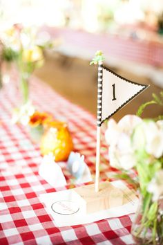 table number on pennant - if doing pennants, a way to carry theme into dining room