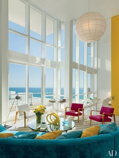 Ocean views take center stage in this Miami Beach apartment by designer John Barman, who installed a retractable, floor-to-ceiling door between the previously boxy spaces of his 1,500-square-foot home   archdigest.com