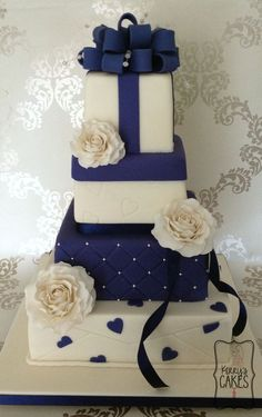 Navy Blue and White wedding cake from Cake Central.  www.cakecentral.com  Please mention that you found them thru Jevel Wedding Plannings Pinterest Account.  Keywords:  #weddingcakes #navybluethemedweddingcake #jevelweddingplanning Follow Us: www.jevelweddingplanning.com  www.facebook.com/jevelweddingplanning/