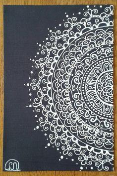 Zentangle - mandala - zendala.  I used a white gelpen and dark blue paper.