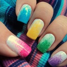 Dabbing bright colours onto your nails with a makeup pad gives a great look to a white mani