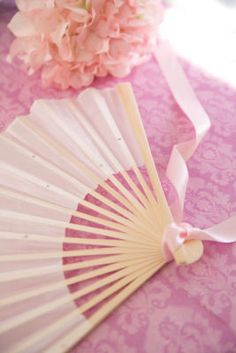 Michaels.com Wedding Department: Romantic Pink Fans Adorn a folding fan with clear or colorful rhinestones, then add ribbon for the perfect finishing touch to create an elegant decoration, favor or accessory. Courtesy of Gartner Studios®