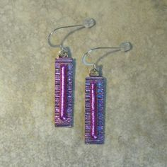 Paula Woodward - These earrings are made from two layers of fused Dichroic glass. A textured lilac base with a layer of pink Dichroic glass and tones of lilac and blue as they catch the light.   They are lightweight to wear, finished with sterling silver ear wires, and come packaged in a gift box. £17