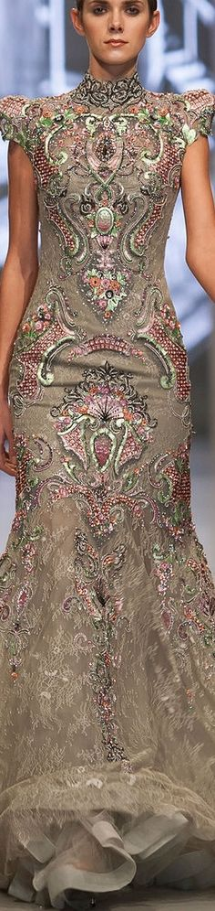 Beautiful piece from the Ezra Couture S/S 2013 collection. Love the colour combination of the heavy embroidery.