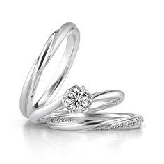 セットリング「Bloomin'」の紹介です。素材PT(プラチナ)で、価格は婚約指輪が310,000円~、結婚指輪のLadies'が133,000円、Men'sが129,000円です。大好きな人がくれたブーケの中から返事のしるしに選ぶ「運命の花」をモチーフにしています。|銀座ダイヤモンドシライシ