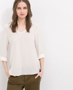 Image 1 of SHOULDER BUTTONED BLOUSE from Zara