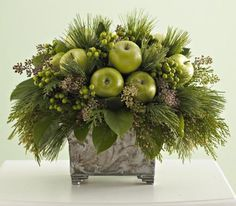 Apple arrangement This simple holiday arrangement feels both fresh and traditional. To make it, you'll need the following materials: florist's foam, a planter, fresh sprigs of greenery, incense cedar, cinnamon oil, florist's picks and green apples. Click ahead for step-by-step instructions.