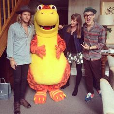 Writer Sarah Barns with McFly's Tom and Dougie - and a giant orange dinosaur