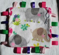 Taggie: Ultra Cuddle Blanket with Ribbons for Baby Girl Friendship. $16.00, via Etsy.
