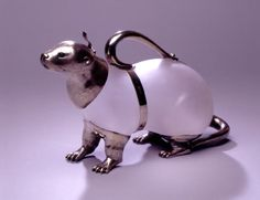 """An English Silver Mounted Seal Claret Jug by Alexander Crichton, circa 1882, after drawings for """"Alice in Wonderland"""""""