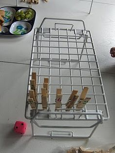 Clothes Pin Game: Use your imagination when creating games with a rack and clothes pin. Counting, Colors, shapes, etc. This is a great fine motor skill as well as promoting cognitive development.