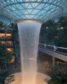 Singapore Marina Bay Sands Gardens by the bay Waterfall Botanical Gardens Singapore via townandtourist Futuristic Architecture, Amazing Architecture, Singapore Architecture, Garden Architecture, Architecture Office, Architecture Design, Natural Architecture, Chinese Architecture, Futuristic Design