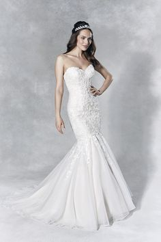 'Gracie' - Make an entrance in this sensational fishtail gown. Intricate beaded lace adorns the bodice, set off with a sparkling row of crystal buttons down the back.