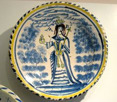 """1705 British Charger showing Queen Anne at the Royal Ontario Museum, Toronto - From the curators' comments: """"Between the 1660s and about 1730, chargers (ornamental serving plates) decorated with royal portraits were manufactured in England. Apparently a charger was normally hung on the wall by a string wound around the projecting foot at the back."""""""