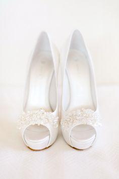 A fun twist on classic white wedding shoes: http://www.stylemepretty.com/little-black-book-blog/2015/05/21/romantic-laduree-inspired-tuscany-beach-wedding/   Photography: Facibeni Fotografia - http://www.photographertuscany.com/