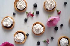 Blueberry Curd Meringue Cups | Melt in your mouth short crust cases filled with blueberry curd and topped with meringue