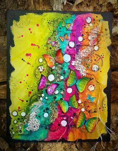 Mixed Media Place, butterflies and rainbow colors.
