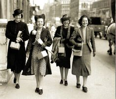 U.K. Women on their way to work with gas masks in boxes, London, August 1939, WWII