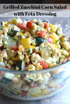 Got too much zucchini? Grab this zesty, savory Grilled Zucchini Corn Salad with Feta Dressing. Gluten-free, vegetarian. www.thekitchengir...