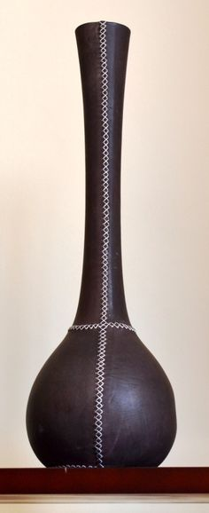 Leather covered wooden vessel