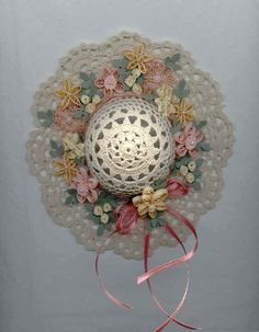Lace doylie hat, decorated with quilled flowers