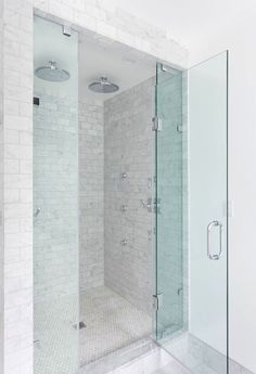 Beautiful bathroom with his and her rainfall shower heads above a marble subway tiled surround adorned with body jets over marble mini hex tiled shower floors finished with a seamless glass door. Shower Jets, Rainfall Shower, Rain Shower, Double Shower Heads, Bathroom Renos, Bathroom Ideas, Bathroom Showers, Bathroom Spa, Downstairs Bathroom