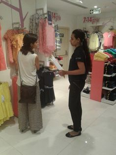 Hiland's Riverfront & Ganges Promotions - Our customer interaction promoter explaining the project details to a customer at Pantaloons, Kolkata.