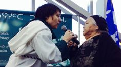 Throat singing - Evie Mark and elder Audla Tullauqa. Throat singing reflects a long oral tradition practiced among Inuit women. Although it's often performed today as entertainment, throat singing developed as a game played by two participants. Throat singers make sounds imitating sounds in nature, carrying on a rhythm until one person laughs or loses their breath.