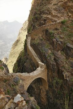 "Shaharah Bridge./// Shaharah or Shehara is a large mountain village and seat of Shaharah District of the 'Amran Governorate, Yemen. The village ""lies at 2600 meters and overlooks mountainous bulging swells"