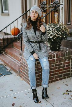 Grey beret, black turtleneck sweater, grey plaid blazer, black belt, distressed boyfriend jeans, black patent booties.Fashion, fashion 2018, fashion trends 2018, fall fashion 2018, winter fashion 2018, street style, beret, beret outfit, casual outfit.